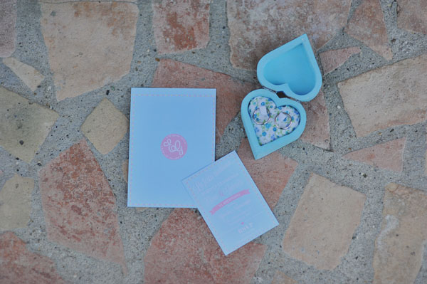 blue and pink wedding invitation + blue ring holder