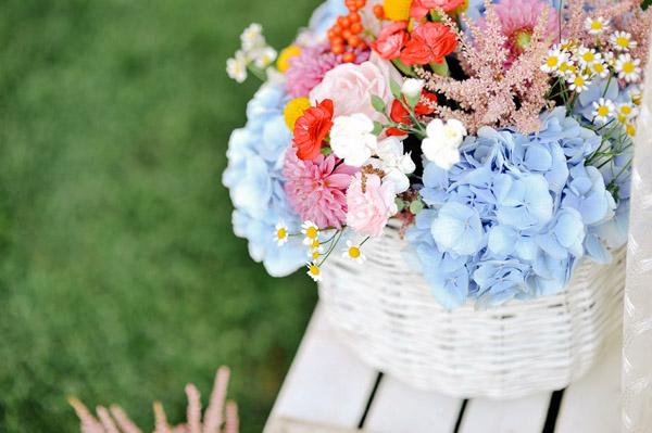wedding decor with hydrangeas, roses, dahlias, carnations, astilbe, chamomile, garden roses, berries and craspedia