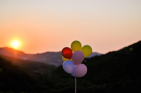 wedding balloons at sunset