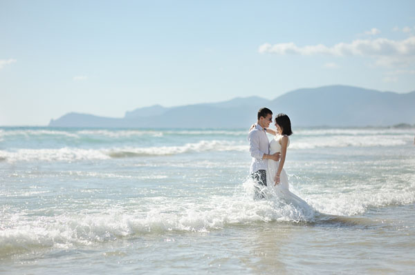 smiling couple together embracing on the beach, Sperlonga, Italy