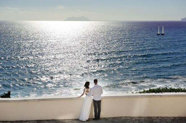bride and groom near sea in wedding day