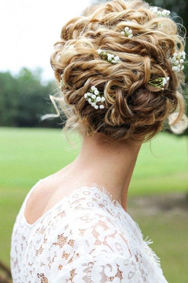 Acconciature sposa capelli raccolti ricci