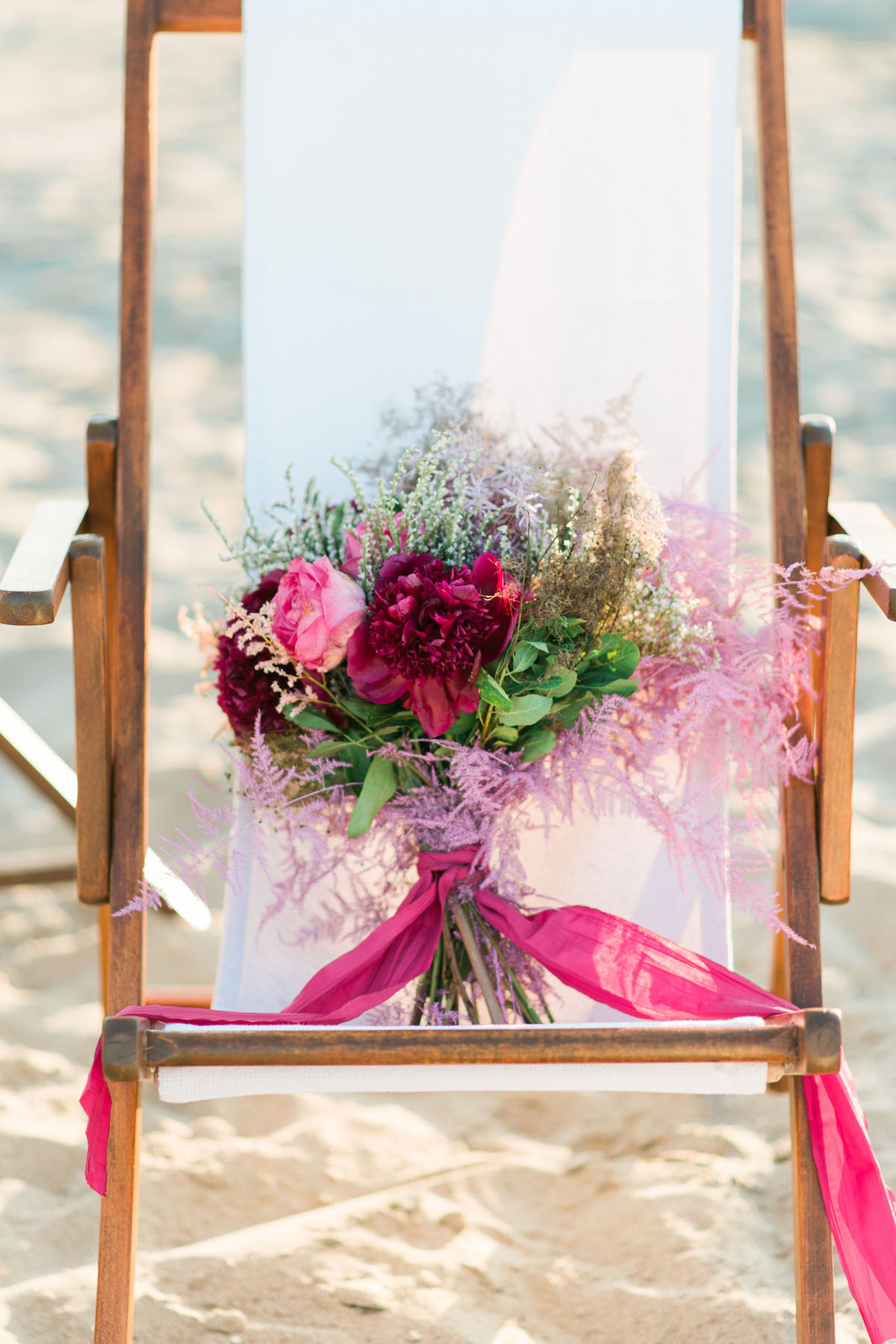 bouquet boho chic rosa e fucsia con peonie
