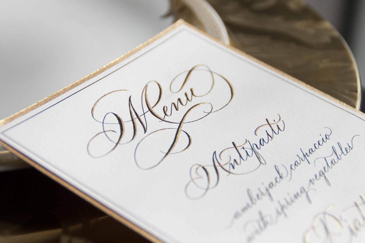 menu oro e nero calligrafico
