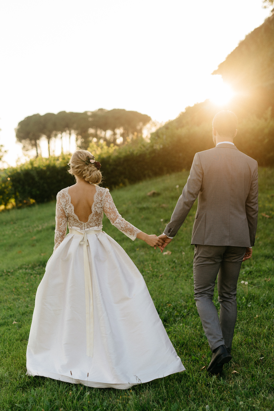 abito da sposa con maniche lunghe
